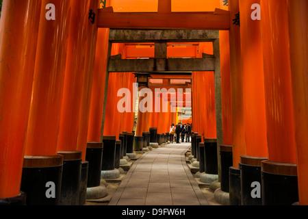 The Endless Red Gates of Kyoto's Fushimi Inari Shrine, Kyoto, Japan - Stock Photo