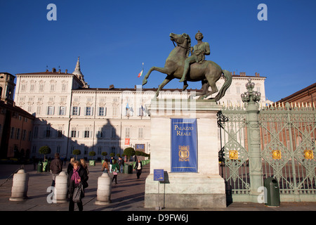 Pollux statue and the Royal Palace of Turin (Palazzo Reale), Turin, Piedmont, Italy - Stock Photo