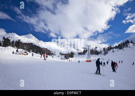 Skiers on piste at Belle Plagne, La Plagne, Savoie, French Alps, France - Stock Photo
