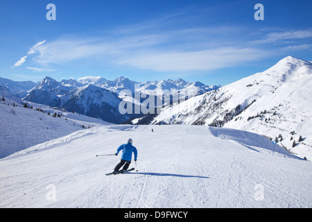 Skiers on Levasset blue piste in winter sunshine, Champagny, La Plagne, French Alps, France - Stock Photo