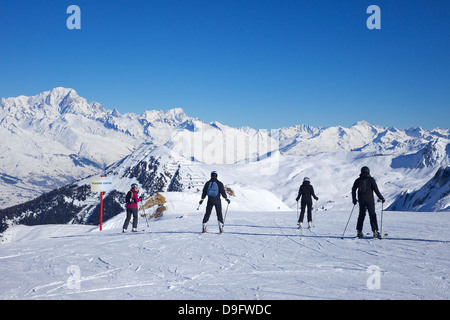 Skiers on the piste to Plagne Centre, La Plagne, French Alps, France - Stock Photo