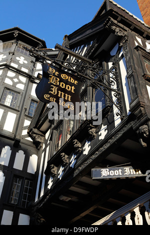 The half-timbered facade of Ye Olde Boot Inn, dating from 1643, a traditional British pub, in Chester, Cheshire, - Stock Photo