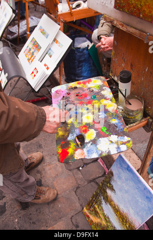 A street artist at work in the famous Place du Tertre in Montmartre, Paris, France - Stock Photo