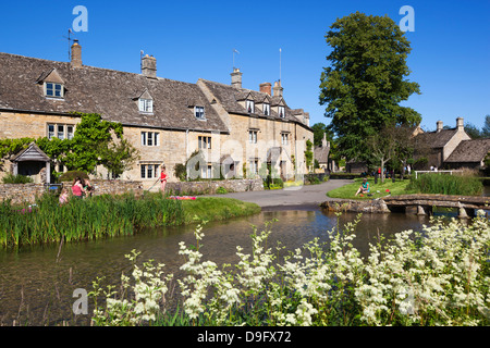 Cotswold cottages on the River Eye, Lower Slaughter, Gloucestershire, Cotswolds, England, UK - Stock Photo