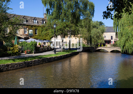 View along the River Windrush, Bourton-on-the-Water, Gloucestershire, Cotswolds, England, UK - Stock Photo