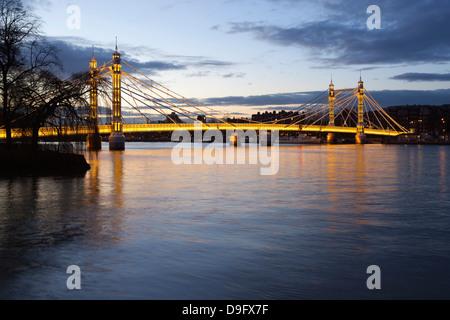 Albert Bridge over the River Thames, Chelsea, London, England, UK - Stock Photo