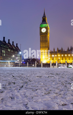 Houses of Parliament and Big Ben in snow, Parliament Square, Westminster, London, England, UK - Stock Photo