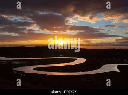 Cuckmere River meanders at sunset, near Seaford, South Downs National Park, East Sussex, England, UK - Stock Photo