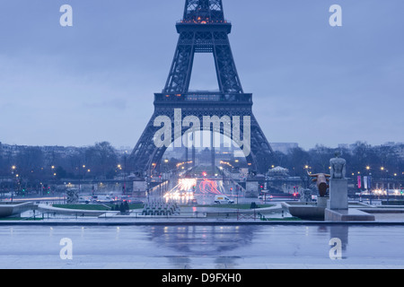 The Eiffel Tower under rain clouds, Paris, France - Stock Photo