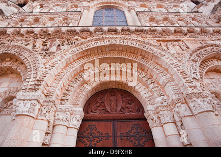 The tympanum on Eglise Notre Dame la Grande in central Poitiers, Vienne, Poitou-Charentes, France - Stock Photo
