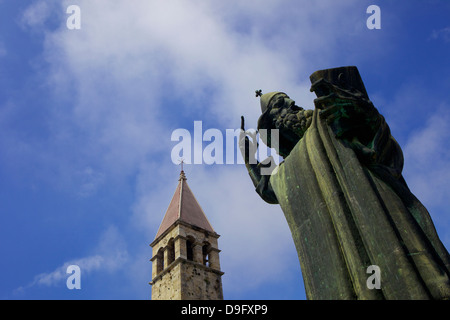 Statue of Grgur Ninski (Gregory of Nin) by Ivan Mestrovic, and the Campanile (bell tower), Split, Dalmatian Coast, - Stock Photo