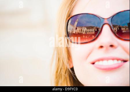 Dubrovnik City Bell Tower reflected in a tourist's sunglasses, Dubrovnik, Dalmatia, Croatia - Stock Photo