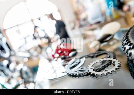 Bicycle mechanic at work in Bike Shop - Stock Photo