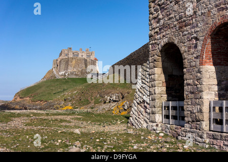 Lindisfarne castle and Lime Kiln on Holy Island, Northumberland, England - Stock Photo