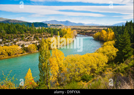 Caravan crossing a bridge on the Clutha River in autumn, Wanaka, South Island, New Zealand - Stock Photo