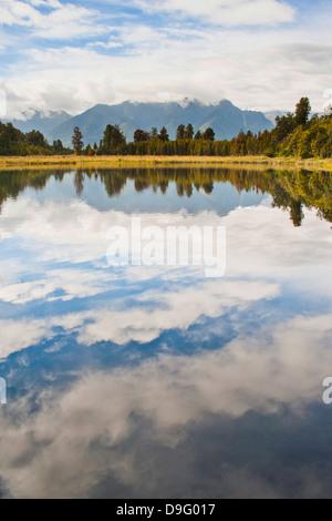 Reflections at Lake Matheson, Westland National Park, UNESCO World Heritage Site, South Island, New Zealand - Stock Photo
