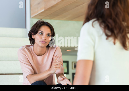 Two female friends arguing at home - Stock Photo