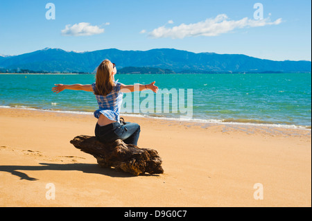 Woman on the beach at Tata Beach, Golden Bay, Tasman Region, South Island, New Zealand - Stock Photo
