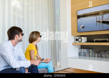 Man and his daughter watching a 3D movie - Stock Photo