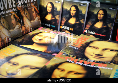 Museum shop window with Mona Lisa books, Musee du Louvre in Paris, France - Jan 2012 - Stock Photo