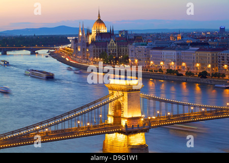 Chain Bridge, River Danube and Hungarian Parliament at dusk, UNESCO World Heritage Site, Budapest, Hungary - Stock Photo