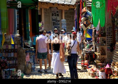 Tourists shopping, Mostar, Bosnia, Bosnia-Herzegovina - Stock Photo