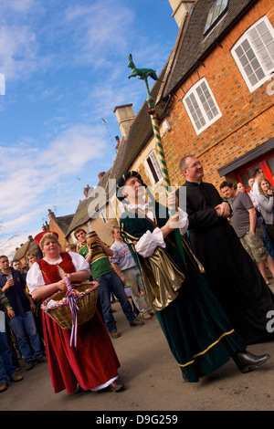 Leaders and participants of the Procession for the Old Annual Custom of Bottle-kicking, Hallaton, Leicestershire, - Stock Photo