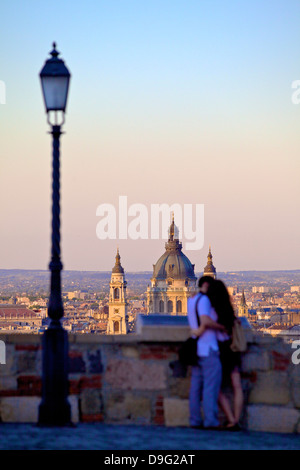 Couple looking at view over the city from Buda Castle, Budapest, Hungary - Stock Photo