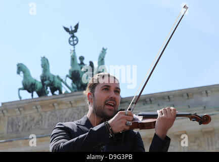Berlin, Germany. 19th June, 2013. German violinist David Garrett poses in front of Brandenburg Gate in Berlin, Germany, - Stock Photo