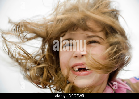 VICTORIA, B.C. – SEPTEMBER 2: Girl with hair blowing in the wind in Victoria British Columbia, Canada on September - Stock Photo