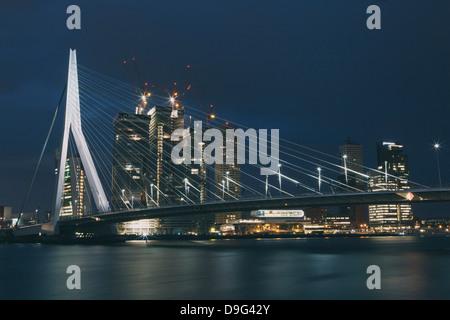 Erasmusbrug (Erasmus Bridge) crossing the Nieuwe Maas River, at night, Rotterdam, South Holland, The Netherlands - Stock Photo