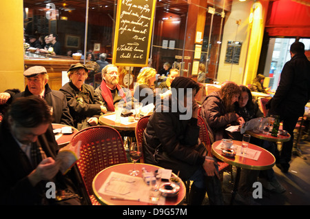People at street cafe in Paris, France - Jan 2012 - Stock Photo