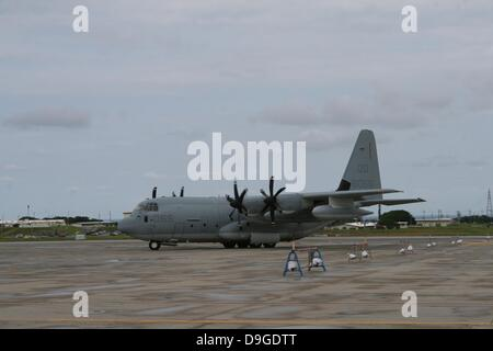 A KC-130J Super Hercules with Marine Aerial Refueler Transport Squadron 152, Marine Aircraft Group 36, 1st Marine Aircraft Wing, III Marine Expeditionary Force taxis down the runway at Marine Corps Air Station Futenma departing to Marine Corps Air Station Stock Photo