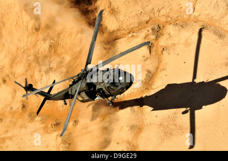 A UH-60 Black Hawk helicopter comes in for a dust landing. Stock Photo