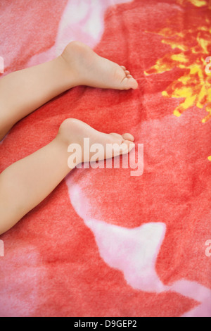 Baby boy sleeping in the bed - Stock Photo