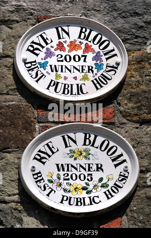 Rye, East Sussex, England, UK. 'Rye in Bloom' winner's plaques on wall of the Old Bell Inn - Stock Photo