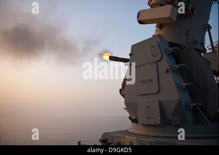 An MK-15 Close-In Weapon System is fired aboard USS Cape St. George. - Stock Photo