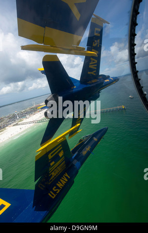 The Blue Angels perform the Diamond 360 maneuver over Florida. - Stock Photo