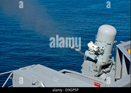 USS Harry S. Truman tests the Close-In Weapons System. - Stock Photo