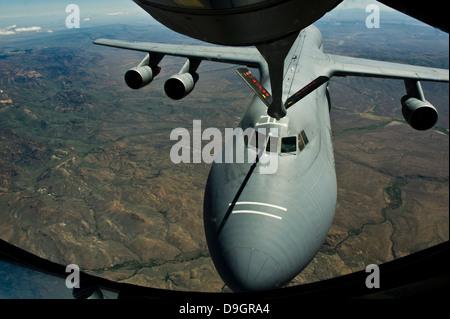 June 11, 2012 - A U.S. Air Force KC-135R Stratotanker aircraft refuels a C-5B Galaxy. - Stock Photo