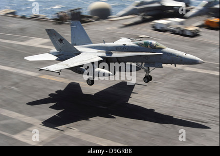 September 13, 2012 - An F/A-18C Hornet lands aboard the Nimitz-class aircraft carrier USS Dwight D. Eisenhower. - Stock Photo