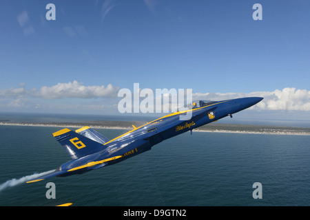 An F/A-18 Hornet from the Blue Angels during a training flight. - Stock Photo
