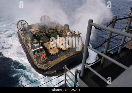 Landing Craft Air Cushion approaches the well deck of USS Bonhomme Richard. - Stock Photo