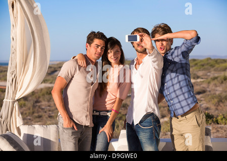 Group of friends photographing themselves with a mobile phone - Stock Photo