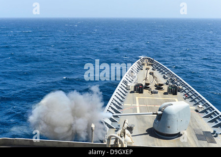 USS Monterey conducts a live-fire exercise. - Stock Photo