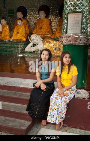 Sunday scene within the Schwedagon pagoda complex in Rangoon(Yangon) in Burma (Myanmar). - Stock Photo