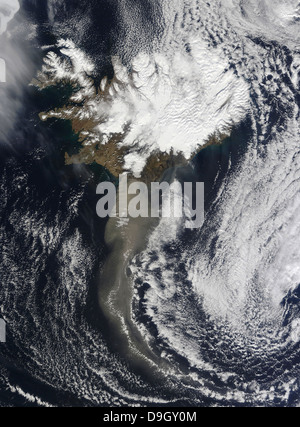 A cloud of ash from Iceland's Eyjafjallajokull volcano extends over the ocean. - Stock Photo