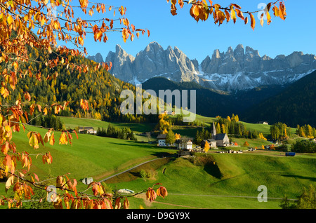 Santa Maddalena with its characteristic church in front of the Odle Dolomites mountain peaks in Val di Funes in - Stock Photo