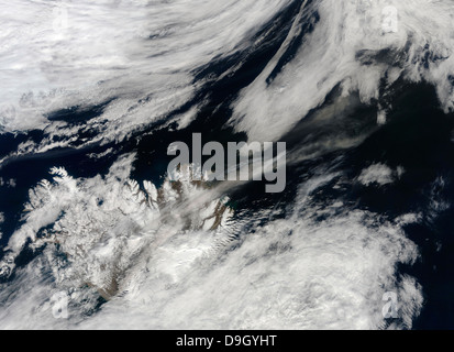 A pale gray ash plume blows from the summit of Eyjafjallajokull volcano. - Stock Photo