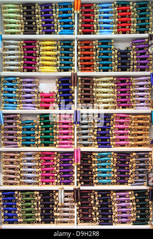 Thread reels for sale in a haberdashery - Stock Photo